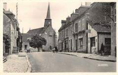 Genouillac La Grande Rue Et Eglise - Genouillac
