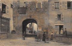 Ambierle Une Vieille Porte Au Fond La Grande Rue Et L'Eglise - Ambierle
