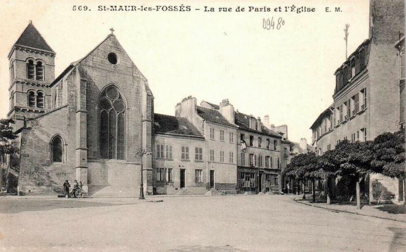 Carte postale ancienne Saint-Maur-des-Fossés.Rue de Paris et église