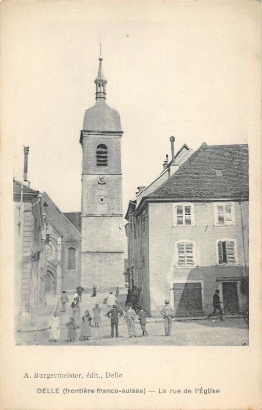 Carte postale ancienne Delle La Rue De L'Eglise à Delle