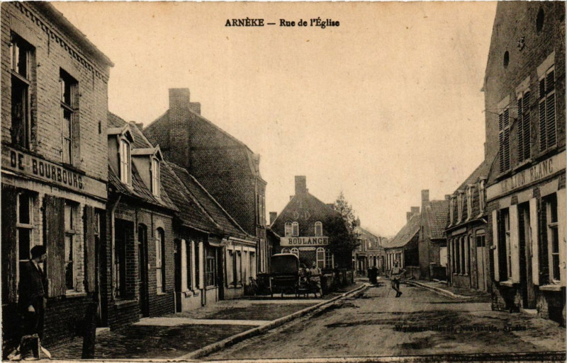Carte postale ancienne Arneke - Rue de l'Eglise à Arnèke